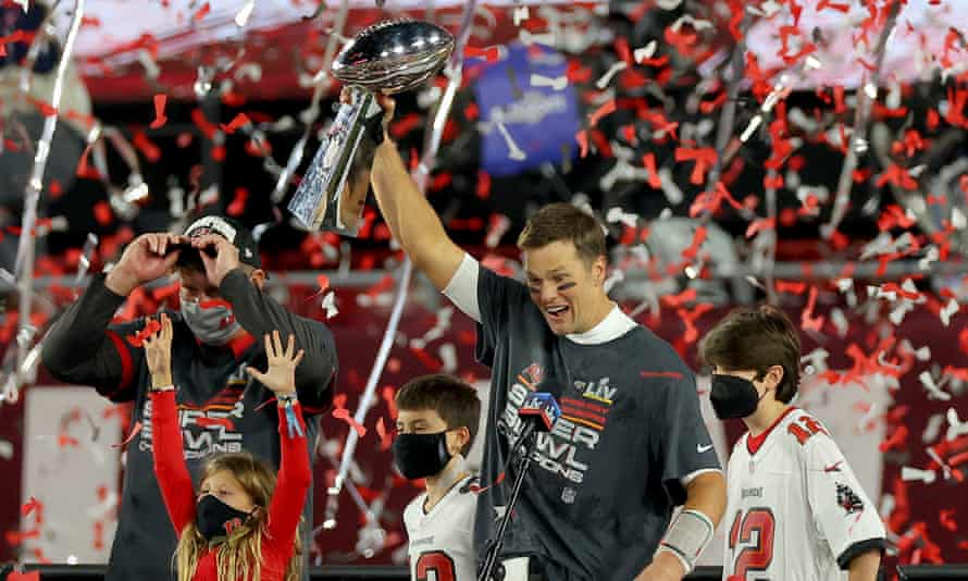 Tom Brady of the Tampa Bay Buccaneers holds up the Lombardi trophy after defeating the Kansas City Chiefs in Super Bowl LV at Raymond James Stadium on 7 February 2021 in Tampa, Florida.