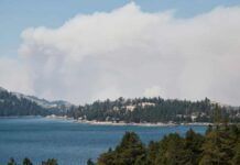 Smoke from the Caldor fire hovers over Caples Lake in Kirkwood, California.